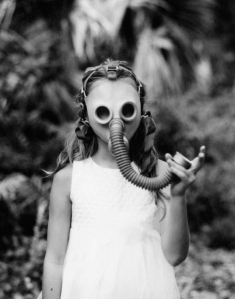 "Gas Mask Girl says, ""It's the end of the world as we know it, and I feel fine!"""